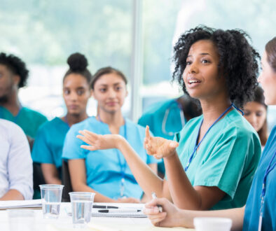 Confident doctor answers question during healthcare conference